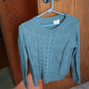 Faded blue knitted sweater